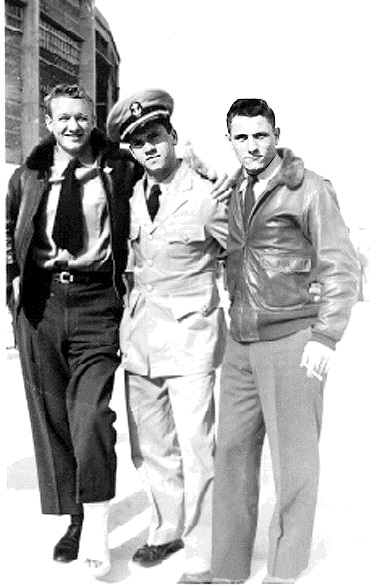 "Vic Manafee (12-47), Bud Goehring, and unknown Mexico City 1947. ""Too crippled to play but just right to travel. Anything to get out of battalion sports and military drill.""  ""All three of us were on the binnacle list for various injuries sustained while playing for the 'Pensacola Goslings' football team. The picture was taken outside the bull fighting (I use the term loosely since the poor bulls never have a chance) stadium sometime after the game with the University of Mexico."""