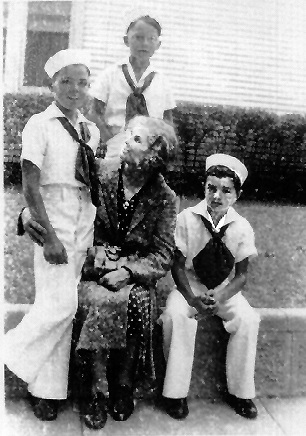 Future Aviator. front: Lou Ives, age 9 (left), Grandmother Ives (center), and Richard Ives, age 7. back: Bill Putman, neighborhood friend