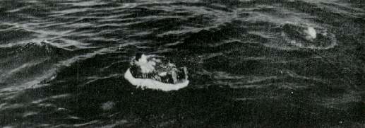 Lou Ives in his life raft before pickup by USS Hailey (DD-556) 2 FEB 1953