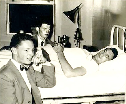 Don Howard and myself visiting LTjg Clayton in bed with broken back.
