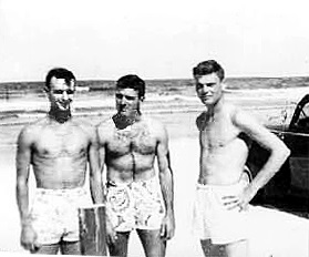 Members of NAS Jacksonville's baseball team, LTjgs Duncan and Barksdale and Midshipman Whitten at JAX beach.