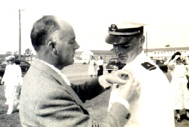 Whitten's father pinning on his WINGS OF GOLD   with Mickey and my mother in background.