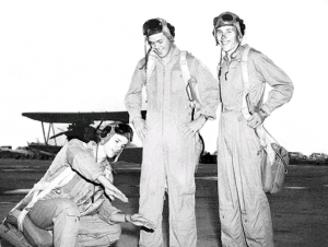 "left to right:  H. L. ""Bob"" Neely, Joe Kane, and Emery Campbell Rodd Field Corpus Christi, Texas(note Stearman in background)"