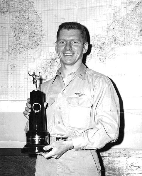 Frank Nulton, ENS, USN     As Coach and competitor at Haneda, AFB Tokyo, Japan, Track and Field Day, 6 June 1951, Frank Nulton leads team to victory over 3,500 Air Force Personnel on Base. VR-21 DET. Haneda had about 90 Naval personnel assigned. The Navy proves again it's not the numbers … it's the quality.  Fleet Logistic AIR WING PACIFIC  AIR TRANSPORT SQUADRON TWENTY-ONE DETACHMENT