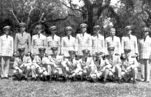 Midshipman 1st class G. C. Canaan, standing second from right, receives his wings of gold, 12 April 1950.U. S. Navy photo.