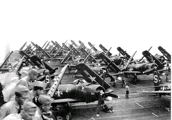 50 miles west of NAS San Diego in the Pacific Ocean, VA-55 and VA-54 AD-2 Skyraiders plus VF-53 F8F-2 Bearcats on the aft end of CV-45 USS Valley Forge