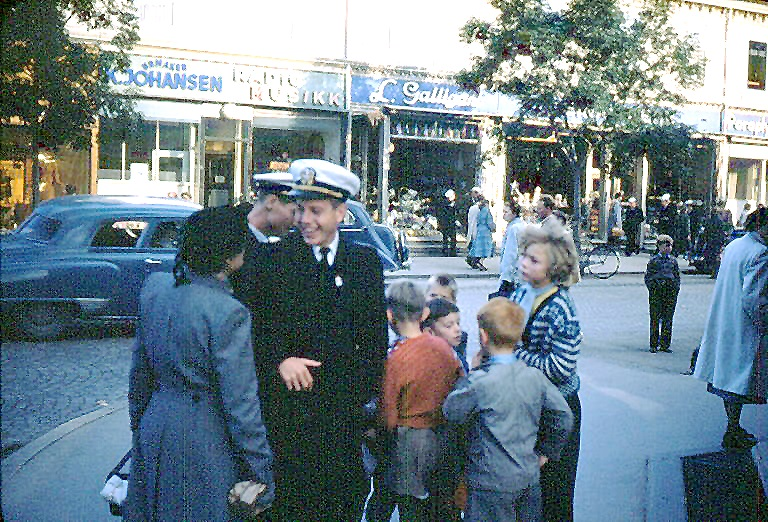 Trondheim: British lady gives Jess Taft advice while other officer (Jack Pickens?) passes out candy.
