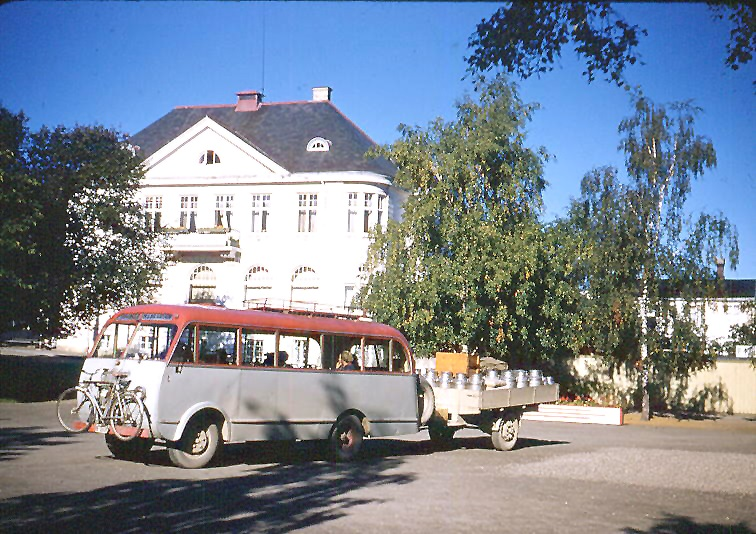Levanger, Norway. Twice daily bus from Skogn carries milk cans and gives Taft and Wilbur a ride.