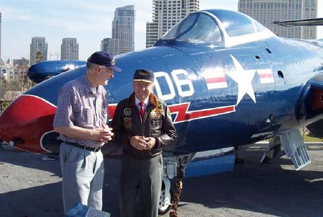 Royce Williams and Ed Bethel, formerly of VF-781, in front of the F9F-5 on the USS Midway in San Diego Harbor, 2005. The F9 is painted in the colors of Royce's F9 when he shot down 3 MiG-15s 40 miles from Vladivostok 18 November 1952. [His story is on the website.]